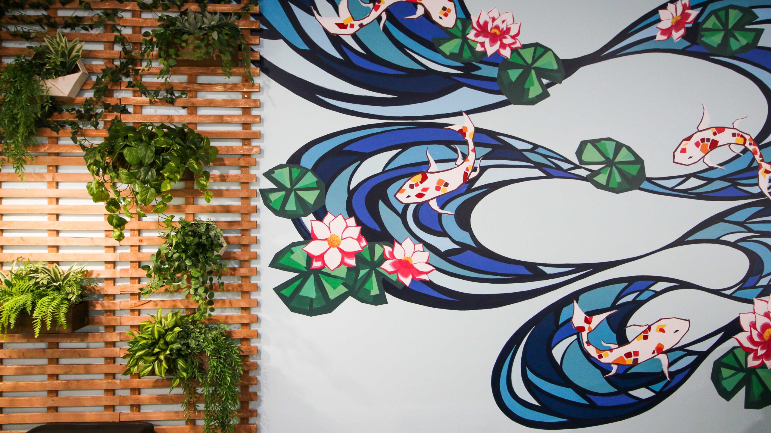 Hand-painted mural of koy fish inside of the Ninja Generation's lounge