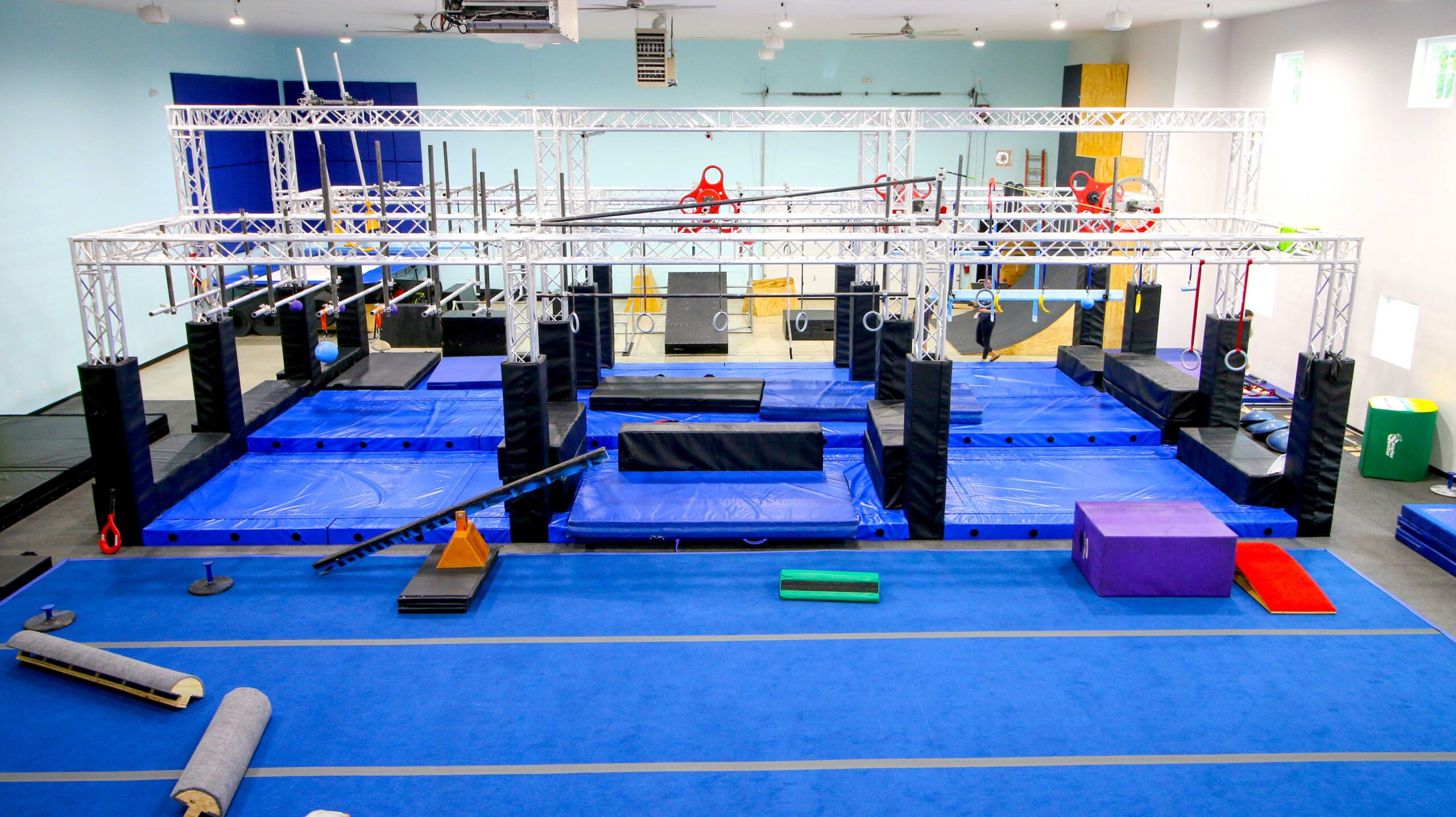 Overview look of the Ninja Generations facility; includes the Ninja Warrior course, spring matts, and balancing equipment